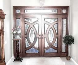 Click on this to go to door index. This picture is of a pair of very high end doors with two sidelights and a transom